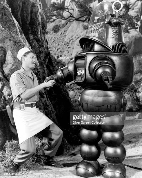 Robby the Robot meeets actor Earl Holliman as the cook in a scene from the science fiction film 'Forbidden Planet' 1956