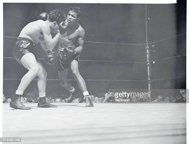 Robby Tops LaMotta in Garden Feature Manhattan New York New York Jake LaMotta rugged Bronx middleweight covers up under a barrage of blows by Ray...