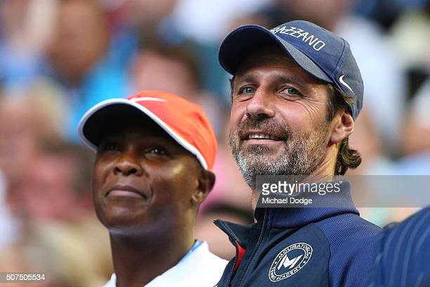Robbye Poole and Patrick Mouratoglou coach of Serena Williams of the United States watches her in the Women's Singles Final match against Angelique...