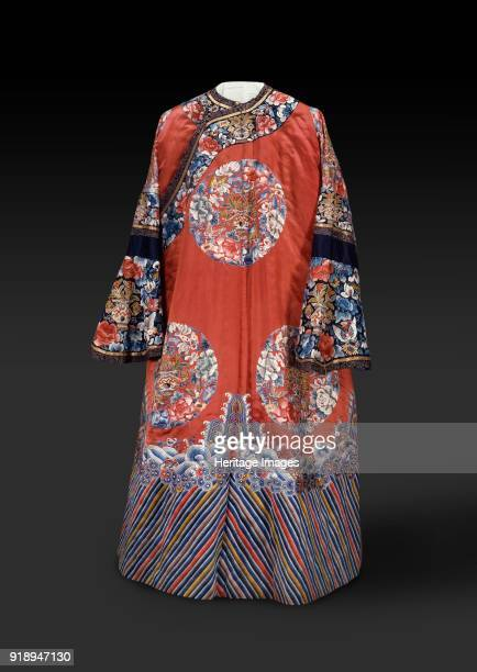 Robe with roundels and waves 19th century Dimensions height x width width at waist 141 x 72 cmwidth width at sleeve 1885 cmwidth width at hem 119 cm