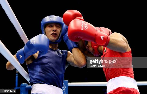Robeisy Ramirez Carrazana of Cuba in action with Andrew Selby of Great Britain during the Men's Fly Boxing on Day 11 of the London 2012 Olympic Games...