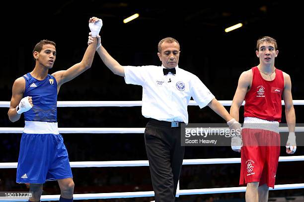 Robeisy Ramirez Carrazana of Cuba reacts as he is declared the winner against Michael Conlan of Ireland during their Men's Fly Boxing semifinal bout...
