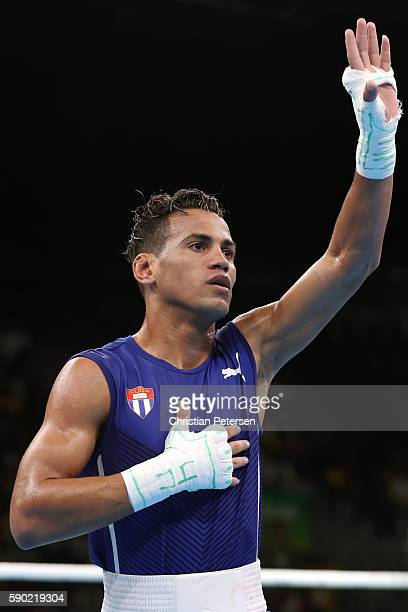 Robeisy Ramirez of Cuba celebrates after defeating Jiawei Zhang of China in the Men's Bantam 56kg Quarterfinal 3 on Day 11 of the Rio 2016 Olympic...