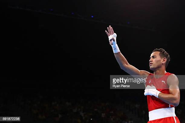 Robeisy Ramirez of Cuba celebrates after defeating Murodjon Akhmadaliev of Uzbekistan in a Men's Bantam Semifinal bout on Day 13 of the 2016 Rio...