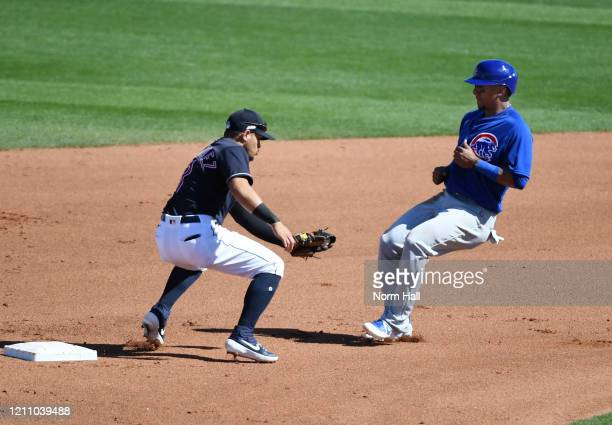 Robel Garcia of the Chicago Cubs is tagged out while attempting to steal second base by Cesar Hernandez of the Cleveland Indians during the fifth...