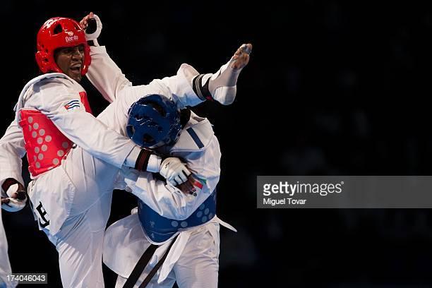 Robelis Despaigner of Cuba competes with Sajjad Mardani of Iran during the 87 kg semifinal combat of WTF World Taekwondo Championships 2013 at the...