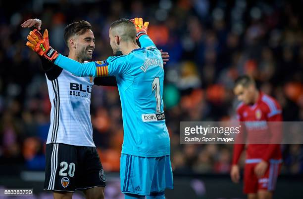 Rober Ibanez and Jaume Domenech of Valencia celebrates a goal during the Copa Del Rey match between Valencia and Zaragoza at Mestalla Stadium on...