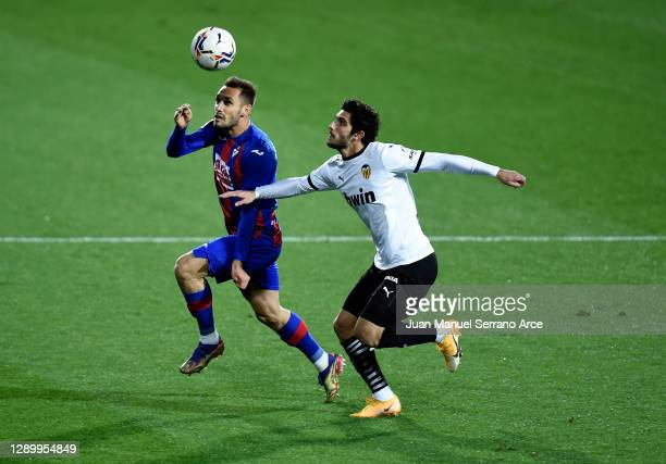 Rober of Eibar challenges for the high ball with Gonçalo Guedes of Valencia during the La Liga Santander match between SD Eibar and Valencia CF at...