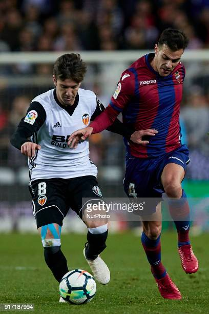 Rober Pier of Levante UD competes for the ball with Vietto of Valencia CF during the La Liga game between Valencia CF and Levante UD at Mestalla on...