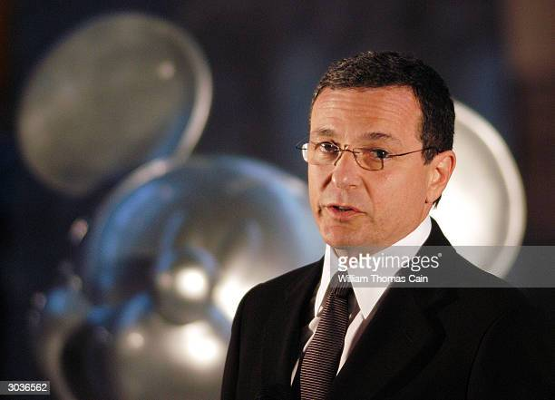 Robert A Iger President and Chief Operating Officer of the Walt Disney Company addresses media members during a news conference on the eve of the...