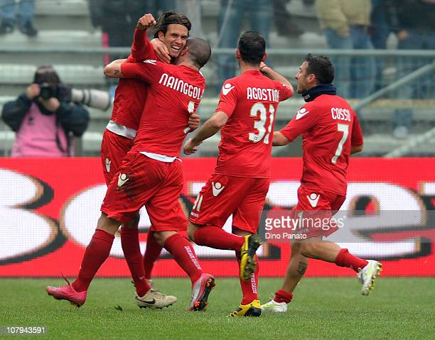 Robert Acquafresca of Cagliari celebrates with Radja Nainggolan and team-mates after scoring the opening goal of the Serie A match between Parma FC...
