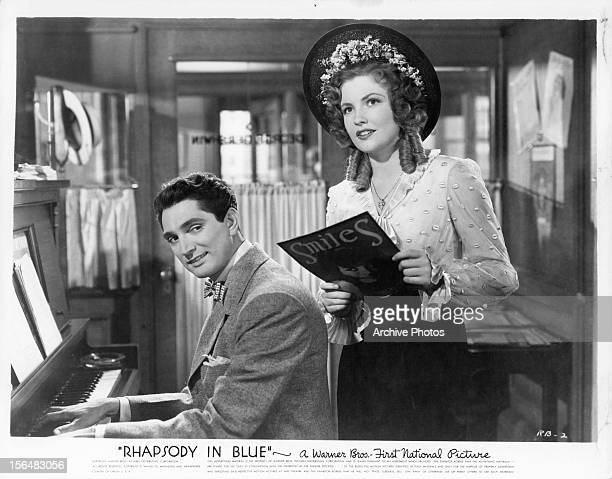 Robert Alda sings with Joan Leslie in a scene from the film 'Rhapsody In Blue' 1945