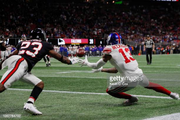 Robert Alford of the Atlanta Falcons breaks a two point conversion intended for Odell Beckham Jr #13 of the New York Giants during the fourth quarter...