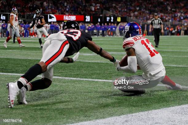 Robert Alford of the Atlanta Falcons breaks a two point conversion intended for Odell Beckham Jr. #13 of the New York Giants during the fourth...