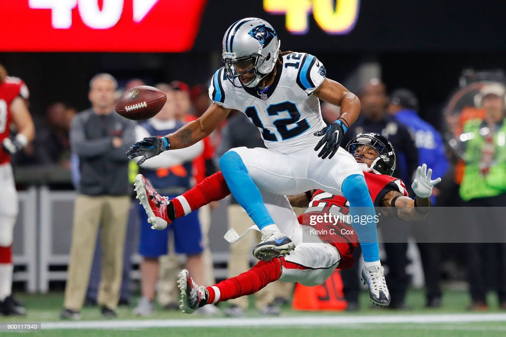 Robert Alford #23 of the Atlanta Falcons breaks up a pass intended for Kaelin Clay #12 of the Carolina Panthers during the first half at Mercedes-Benz Stadium on December 31, 2017 in Atlanta, Georgia.