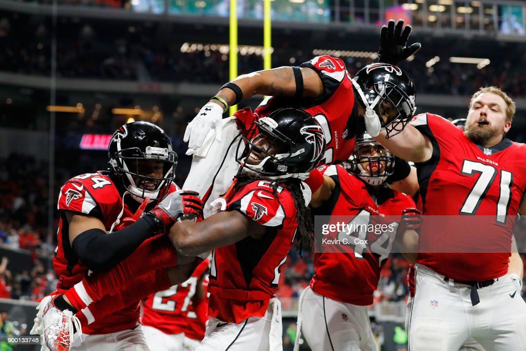 Robert Alford #23 of the Atlanta Falcons celebrates with Desmond Trufant #21 after an interception to end the game against the Carolina Panthers at Mercedes-Benz Stadium on December 31, 2017 in Atlanta, Georgia.