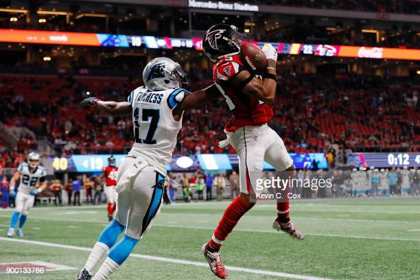 Robert Alford of the Atlanta Falcons intercepts a pass intended for Devin Funchess of the Carolina Panthers to end the game against the Carolina...