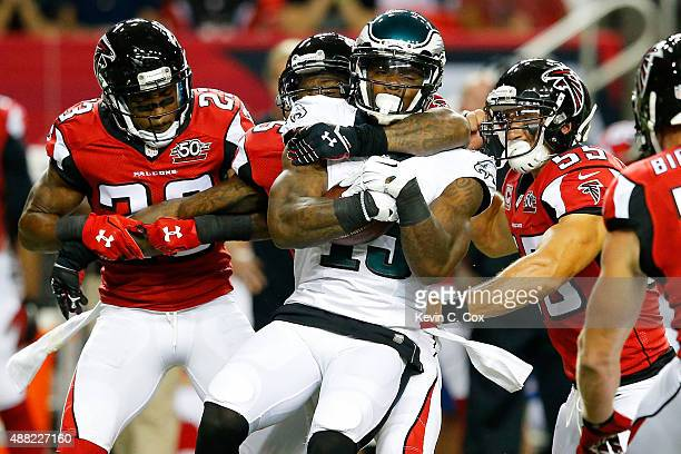 Robert Alford William Moore and Paul Worrilow of the Atlanta Falcons tackled Josh Huff of the Philadelphia Eagles during the first half at the...