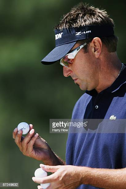 Robert Allenby of Australia looks at his ball on the seventh hole during practice for The Masters on April 4 2006 at the Augusta National Golf Club...