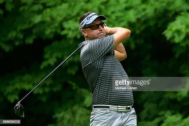 Robert Allenby of Australia plays his shot from the 17th tee during the continuation of the first round of the John Deere Classic at TPC Deere Run on...