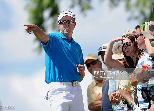Robert Allenby of Australia talks with fans during round two of the 90th PGA Championship at Oakland Hills Country Club on August 8 2008 in...