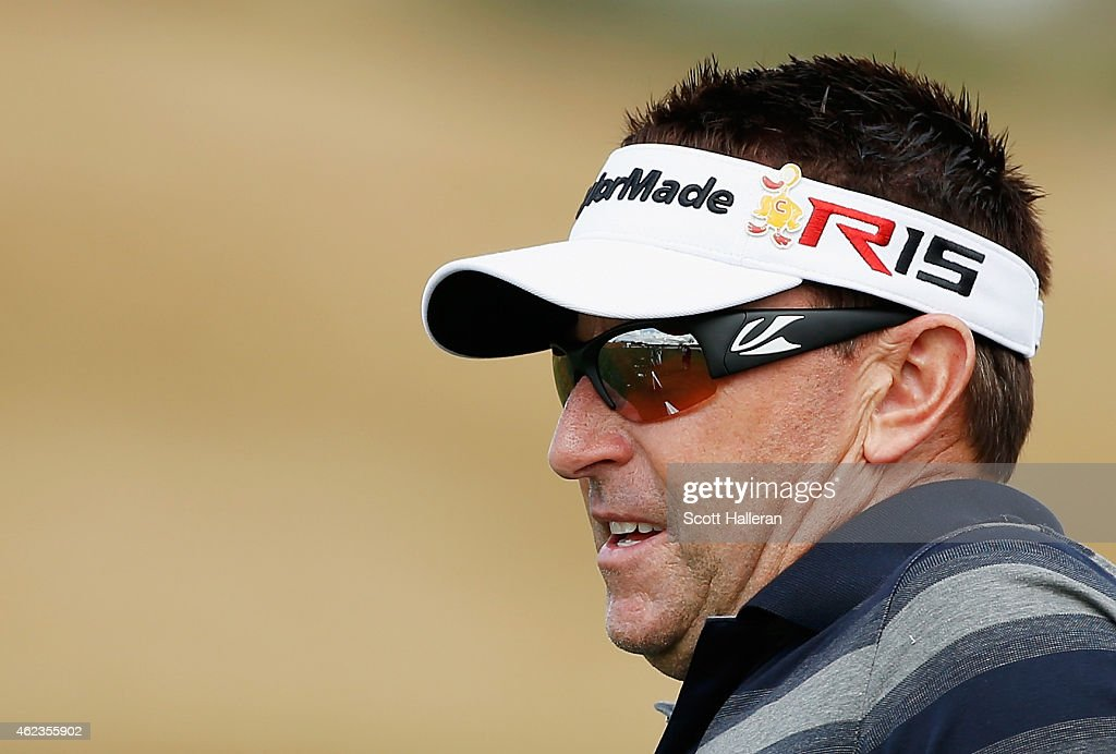 Robert Allenby of Australia waits on the practice ground prior to the start of the Waste Management Phoenix Open at TPC Scottsdale on January 27, 2015 in Scottsdale, Arizona.