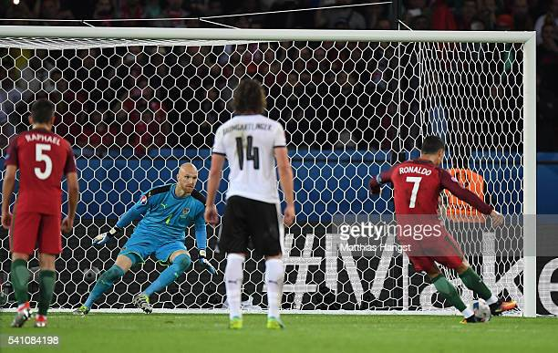 Robert Almer of Austria attempts to save as Cristiano Ronaldo of Portugal hits the post from the penalty spot during the UEFA EURO 2016 Group F match...