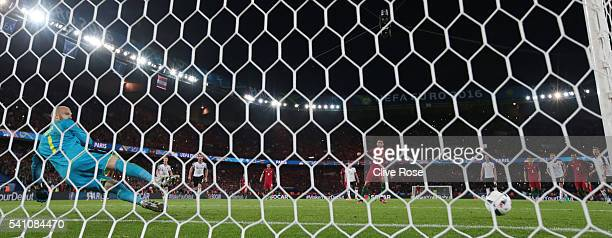 Robert Almer of Austria dives the wrong way as Cristiano Ronaldo of Portugal hits the post from a penalty during the UEFA EURO 2016 Group F match...