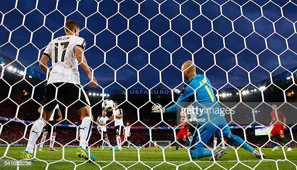 Robert Almer of Austria makes a save with Florian Klein of Austria on the line during the UEFA EURO 2016 Group F match between Portugal and Austria...