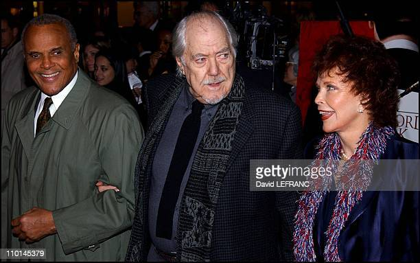 Robert Altman and wife Harry Belafonte at New York Premiere of Robert Altman's Gosford Park at the Ziegfeld Theater in New York United States on...
