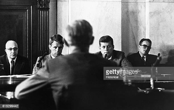 Robert and John F. Kennedy at the McClellan hearings on labor racketeering, aimed at Jimmy Hoffa and the Teamsters Union. John F. Kennedy is a...
