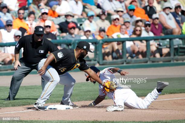 Robert Andino of the Baltimore Orioles is tagged out trying to advance to third base by Jason Rogers of the Pittsburgh Pirates in the fifth inning of...
