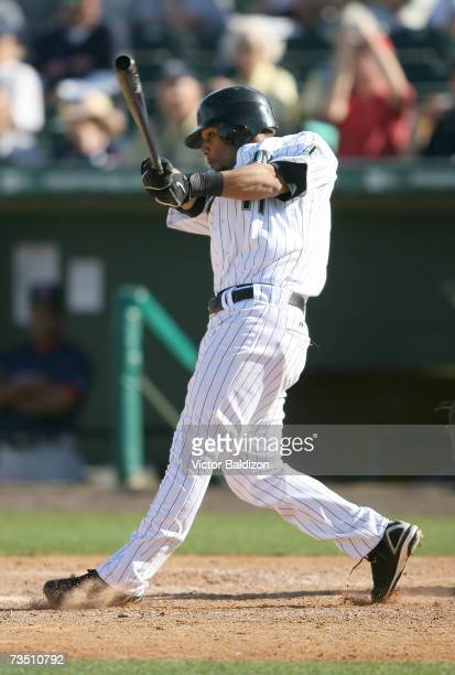 Robert Andino of the Florida Marlins hits against the Boston Red Sox during a Spring Training game on March 6, 2007 at Roger Dean Stadium in Jupiter,...