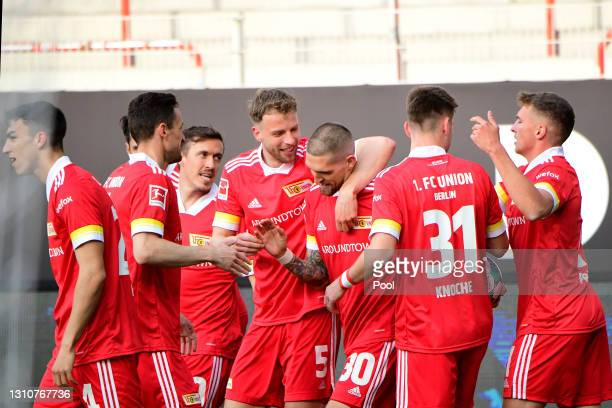 Robert Andrich of 1. FC Union Berlin celebrates with team mate Marvin Friedrich after scoring their side's first goal during the Bundesliga match...