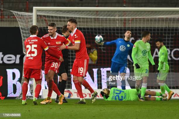 Robert Andrich of 1. FC Union Berlin celebrates with teammates Christopher Lenz and Florian Hubner after scoring his team's second goal during the...