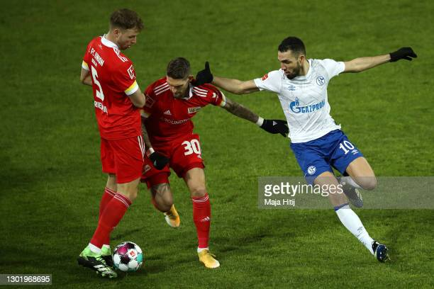 Robert Andrich of 1. FC Union Berlin is challenged by Nabil Bentaleb of FC Schalke 04 during the Bundesliga match between 1. FC Union Berlin and FC...