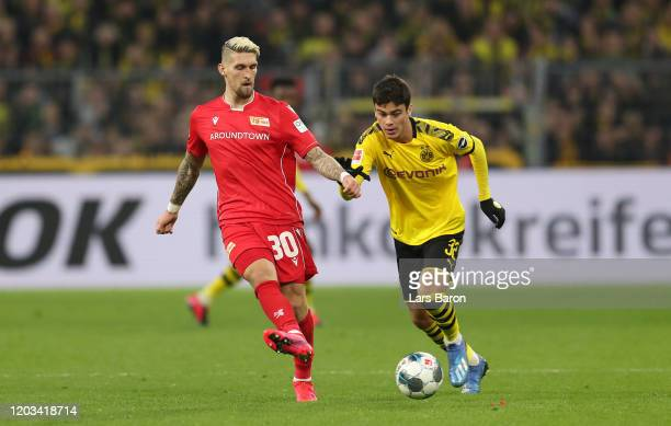 Robert Andrich of Berlin runs next to Giovanni Reyna of Dortmund during the Bundesliga match between Borussia Dortmund and 1 FC Union Berlin at...