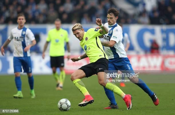 Robert Andrich of Wiesbaden and Dennis Erdmann of Magdeburg vie during the 3 Liga match between 1 FC Magdeburg and SV Wehen Wiesbaden at MDCCArena on...
