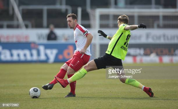 Robert Andrich of Wiesbaden tackles Maik Kegel of Cologne during the 3 Liga match between SC Fortuna Koeln and SV Wehen Wiesbaden at Suedstadion on...