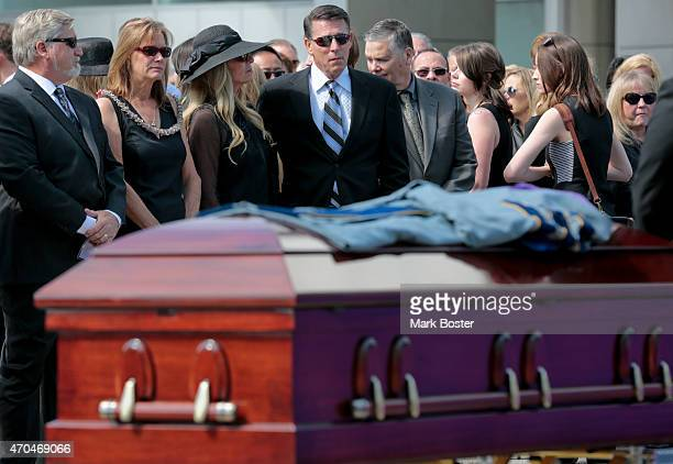"""Robert Anthony Schuller and his wife Donna, watch while his father, """"Hour Of Power"""" and Crystal Cathedral founder, Robert H. Schuller's casket rolls..."""
