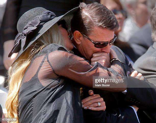 """Robert Anthony Schuller is comforted by his wife Donna, after delivering a tribute to his father, """"Hour Of Power"""" and Crystal Cathedral founder,..."""