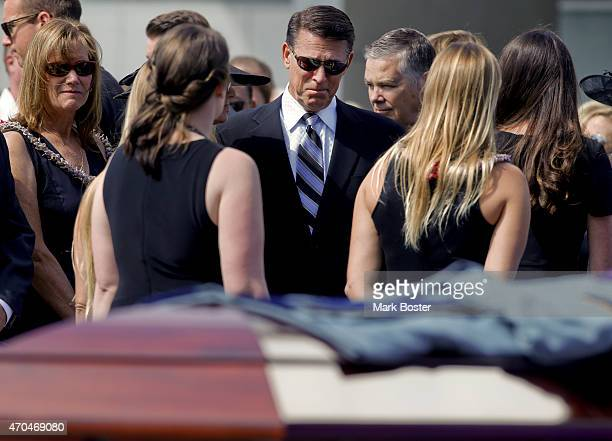 """Robert Anthony Schuller watches while the casket of his father, """"Hour Of Power"""" and Crystal Cathedral founder, Robert H. Schuller passes during..."""