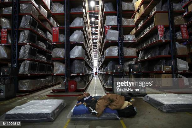 Robert Anthony Torres rests in the warehouse of Gallery Furniture a local furniture store offering shelter to Hurricane Harvey evacuees August 31...