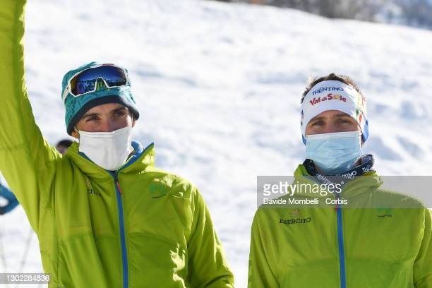 Robert Antonioli and Davide Magnini on the podium celebrate second place during Italian Team Ski Mountaineering Championships on February 14, 2021 in...