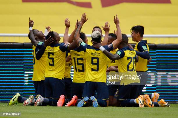 Robert Arboleda of Ecuador celebrates after scoring the first goal of his team with teammates during a match between Ecuador and Colombia as part of...