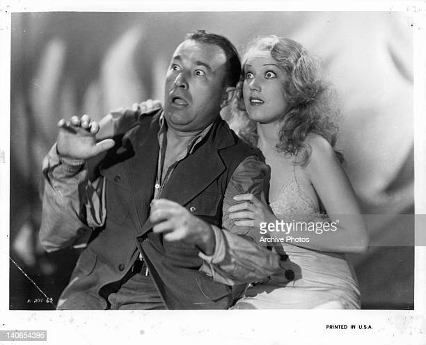 Robert Armstrong and Fay Wray looking up in horror in a scene from the film 'King Kong' 1933