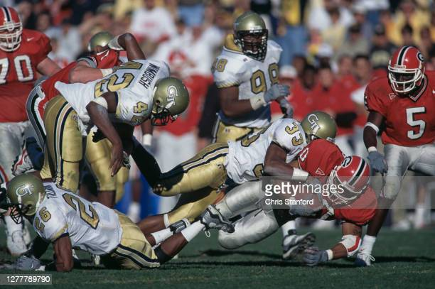Robert Arnaud, Running Back for the University of Georgia Bulldogs is tackled by Chris Young, Defensive Back for the Georgia Tech Yellow Jackets...