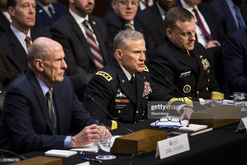 Robert Ashley, director of the National Security Agency (NSA), center, testifies during a Senate Intelligence Committee hearing on worldwide threats in Washington, D.C., U.S., on Feb. 13, 2018. From missiles to cyberattacks, the annual intelligence assessment of global threats paints a world where China and Russia seek to upend U.S. influence as allies uncertain of American commitment may turn away from Washington. Photographer: Zach Gibson/Bloomberg via Getty Images