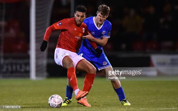 Robert Atkinson of Eastleigh and Daniel Powell of Crewe Alexandra in action during the FA Cup Second Round Replay match between Crewe Alexandra and...
