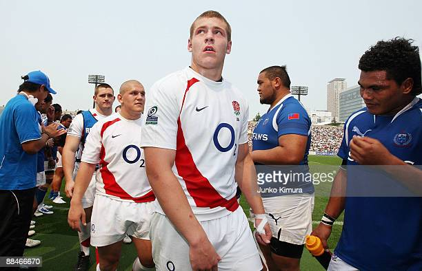 Robert Baker and James Clark of England leave the field after playing the IRB Junior World Championship Japan 2009 match between England and Samoa at...
